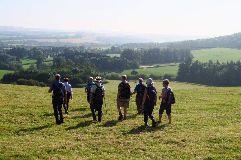 As we head downhill with views over the Cotswolds