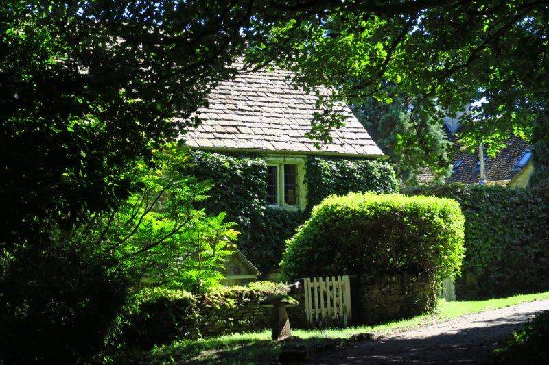Cotswold cottages nestling in the trees