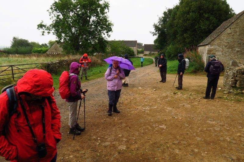 On come waterproofs and up go umbrellas