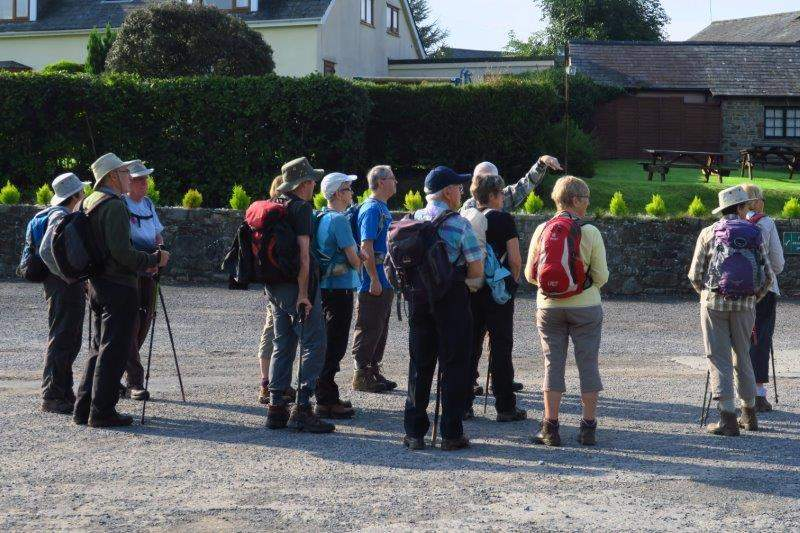 Mike's group look in the general direction of the walk both groups  having met in the same car park