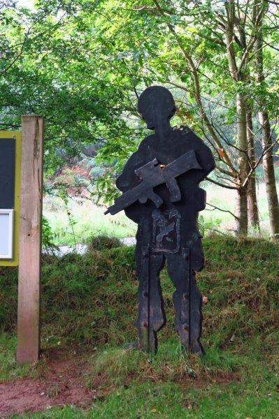 A wooden soldier stands guard in our car park
