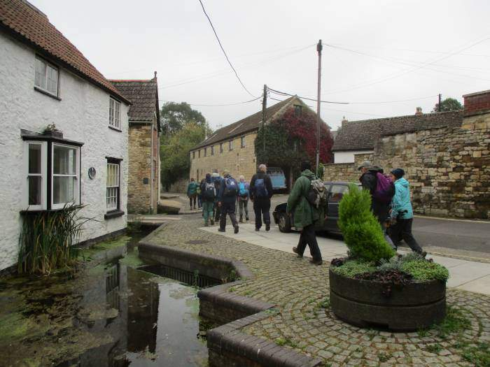 And our group sets off through the town
