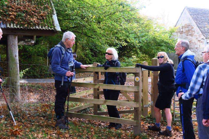 A pause while Mike points out a gate installed in memory of one of our  members