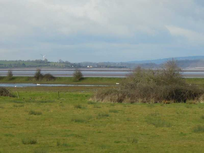Zooming in to a wind turbine across the Severn near Lydney
