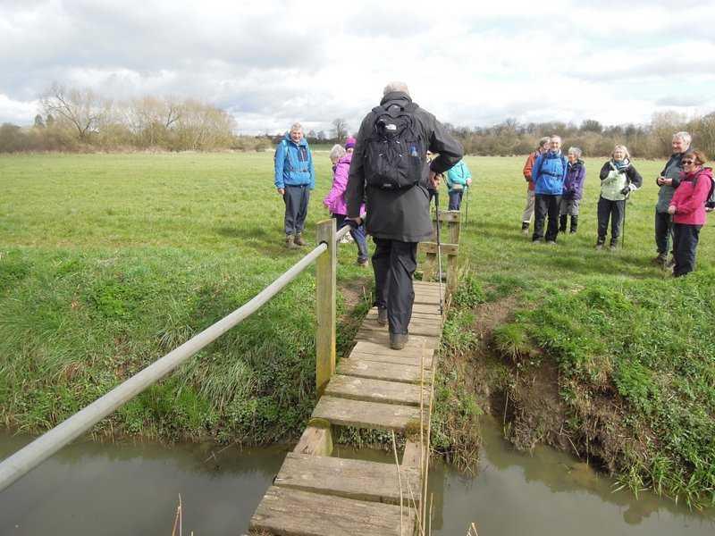To cross this dodgy footbridge