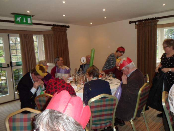 Size of balloon was a serious challenge for the male members on Table 1, while the ladies chatted