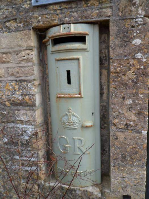 Post box. Which George? No regnal number. And why is it grey?