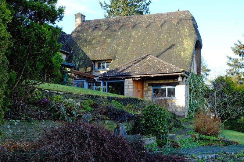 Past a thatched cottage