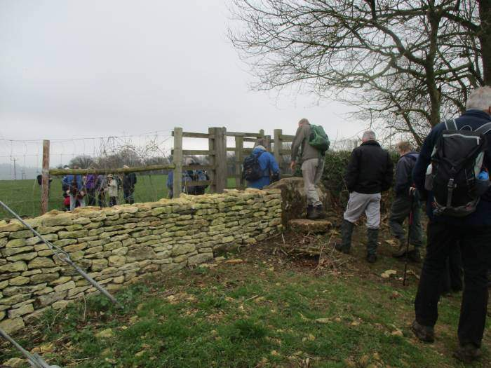 We cross the stone stile by the deer fence