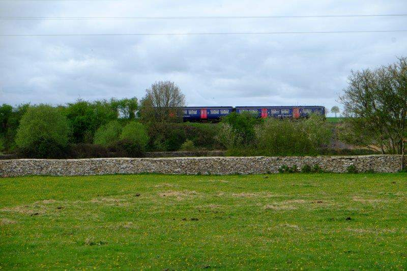 A train passes by on the nearby railway line