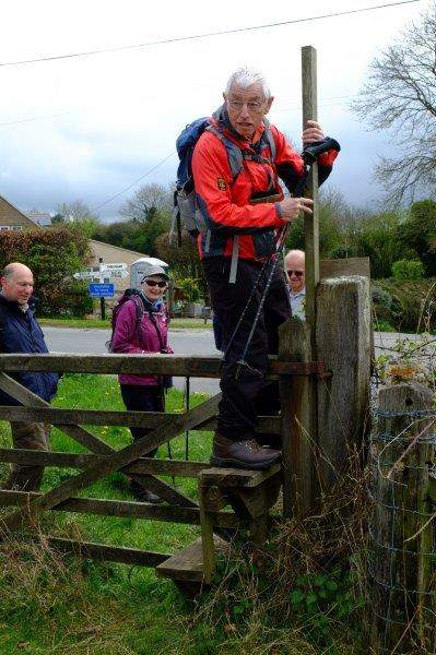 Mike climbs over a rather wobbly stile