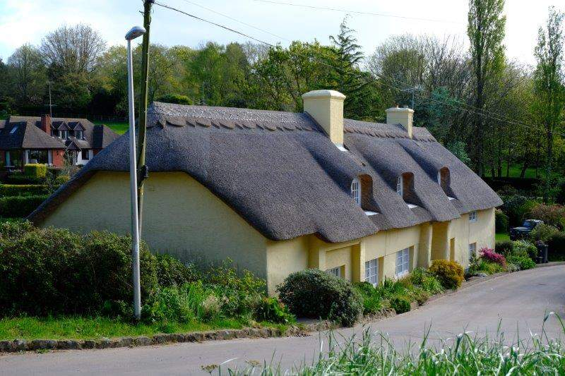 Past a recently refurbished thatch cottage
