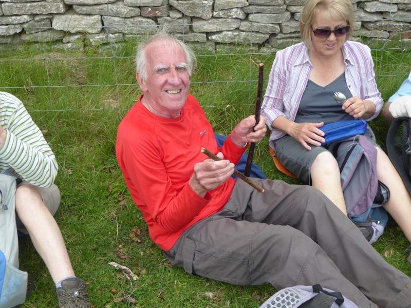 John manages to sit on his 55 year old stick and break it. (His first disaster of the day).  Keith takes it home to mend it for him