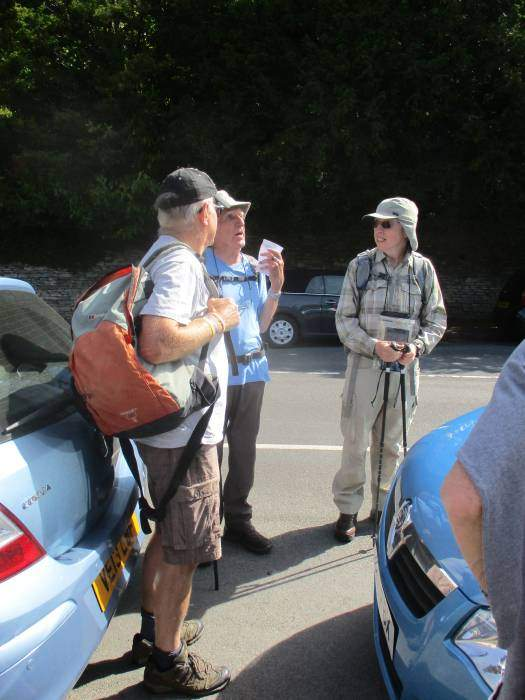 Stuffed between the cars, he explains his walk