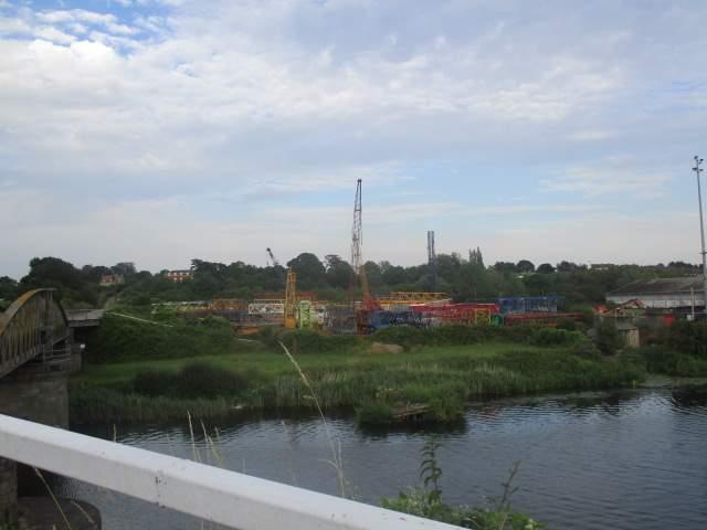 A lego-coloured scrapyard of cranes