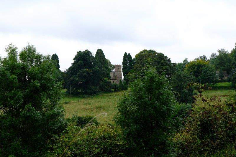 Edgeworth Church peeping out between the trees