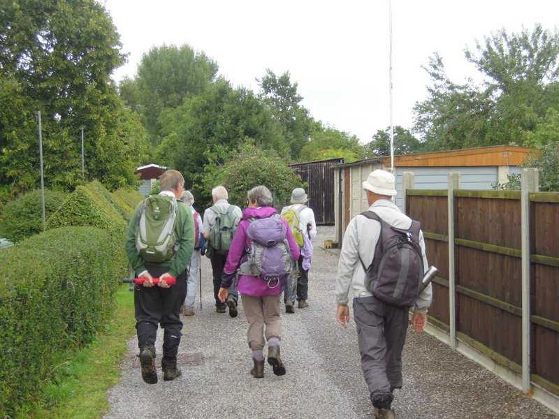 We head back towards the orchard