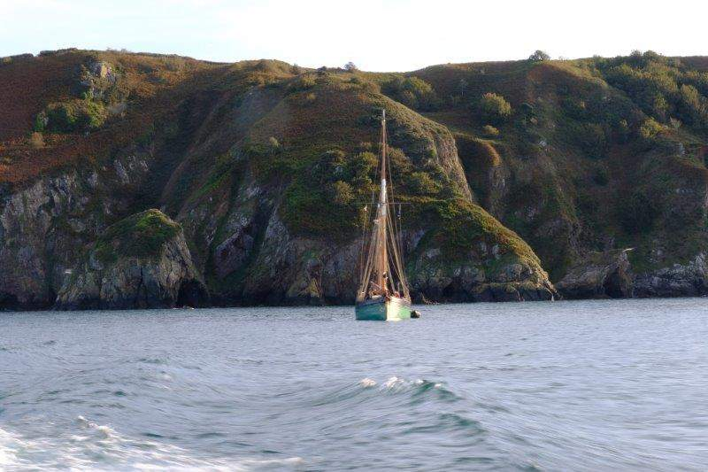 Boat moored under the cliff