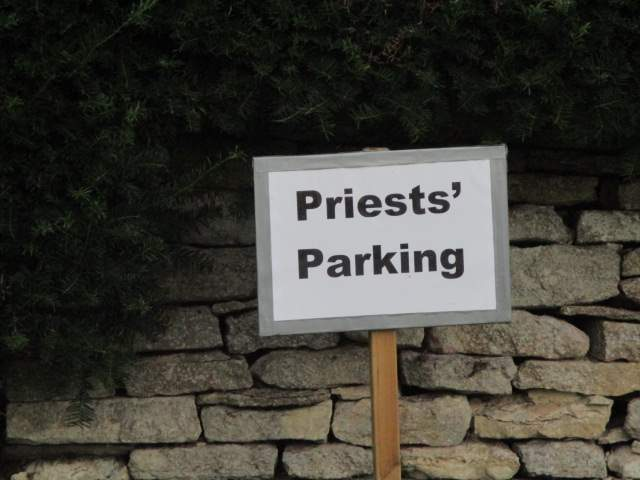 So why do they need parking for more than 1 priest? Or maybe a lesson in apostrophes?
