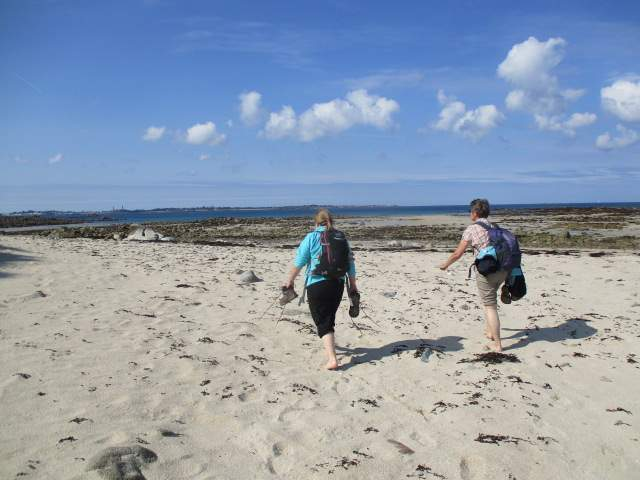 We split up here. It's possible to walk most of the way round the north of the island on the sandy beach