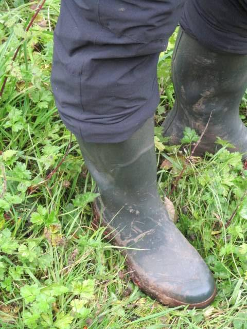 Sue prepares her wellies and trousers for the rain
