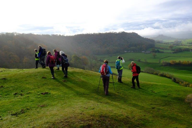 As we stand on one of the viewpoints and look down the Cotswolds with  Downham Hill in the distance