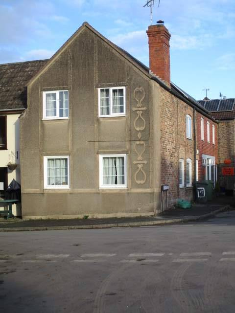 The markings on the wall of the house opposite the Red Lion at Arlingham - what are they?
