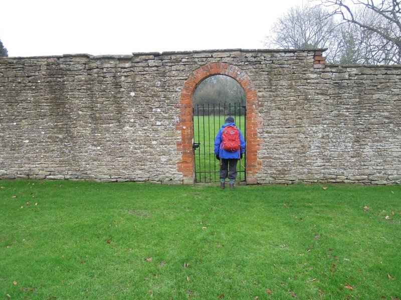 Margaret can't resist a peep though the archway