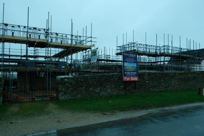 Before heading up to Minchinhampton past a new housing development