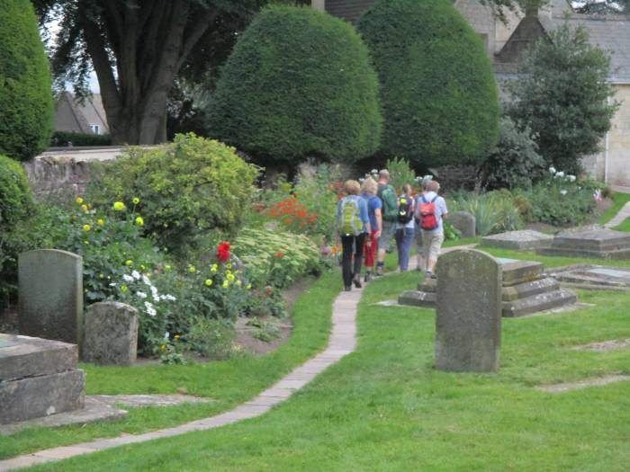 Along the side of the churchyard