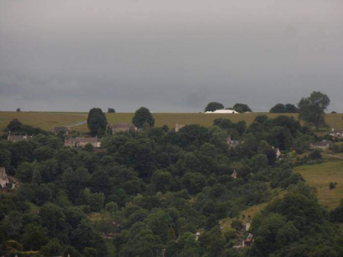 Across the valley a marquee can be seen on Minchinhampton Common