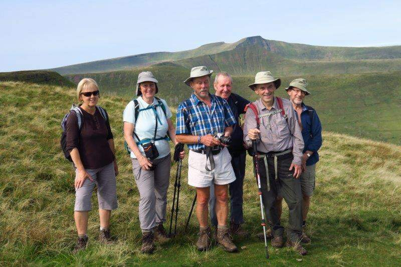A group photo with Cribyn, Pen y Fan and Corn Du behind us