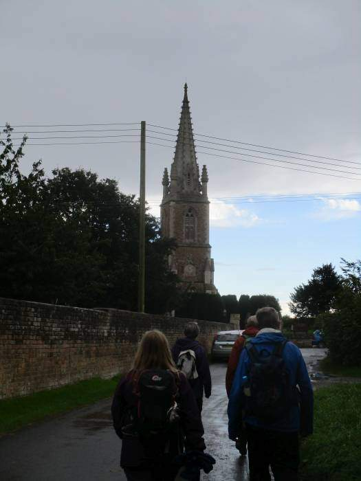 We walk to Fretherne Church where volunteers sell us drinks and cake (and in Steve's case, a bacon butty)