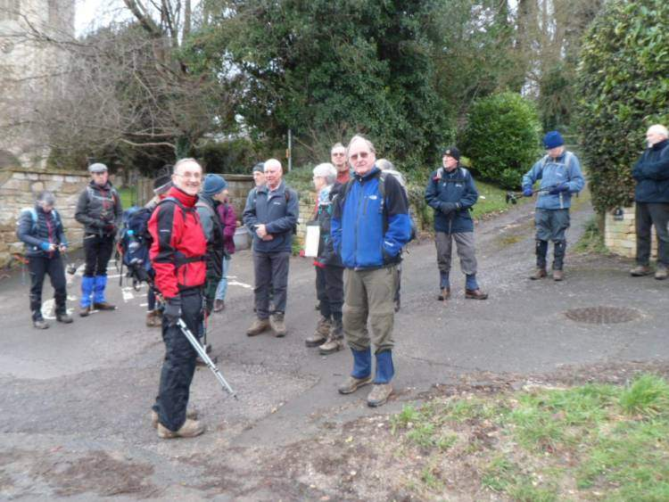 We gather outside St. Giles' Church in Uley for Karen and Tony's hilly walk