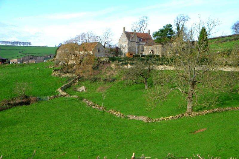 Past a large farmhouse