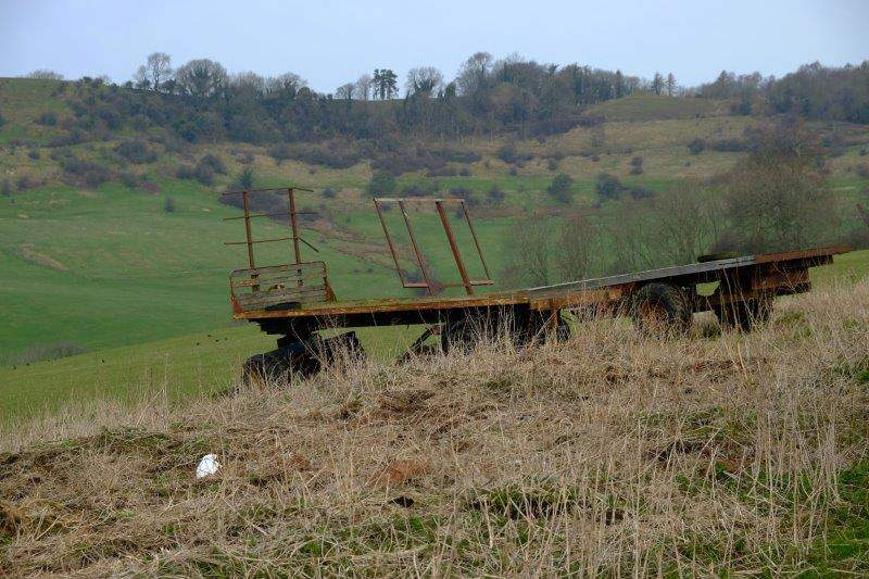 On downhill passing some old farm carts