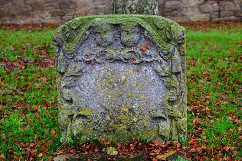 A very old gravestone in the churchyard