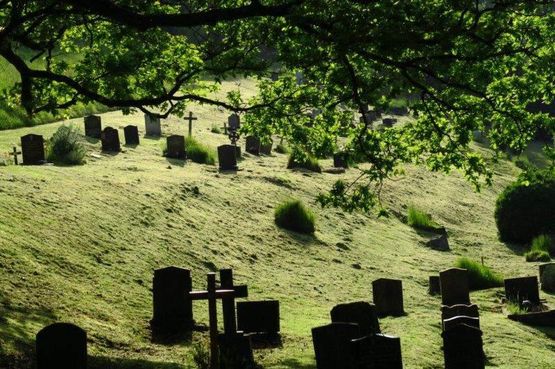 As we walk through Brimscombe churchyard