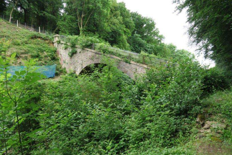 Over a precipitious bridge