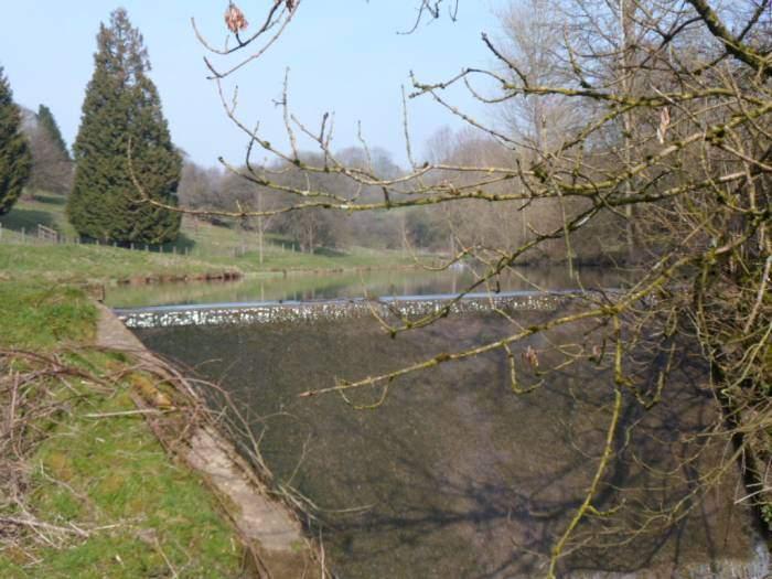 We cross a footbridge over the lake spillway