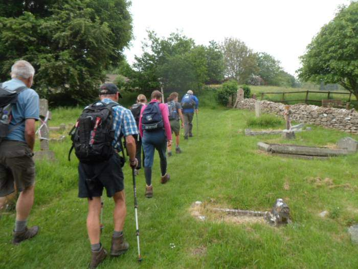 We head up through the churchyard on this incredibly humid day