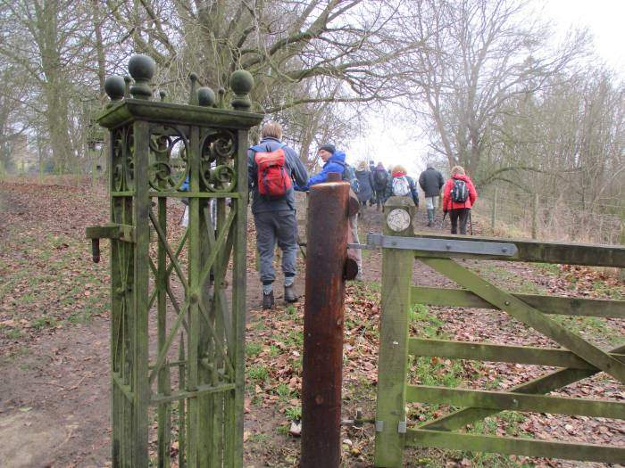 At an iron gate post, the path bypasses Sudeley Castle