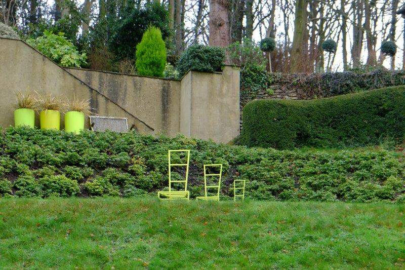 3 chairs. 3 tubs. 3 bushes. Significant?