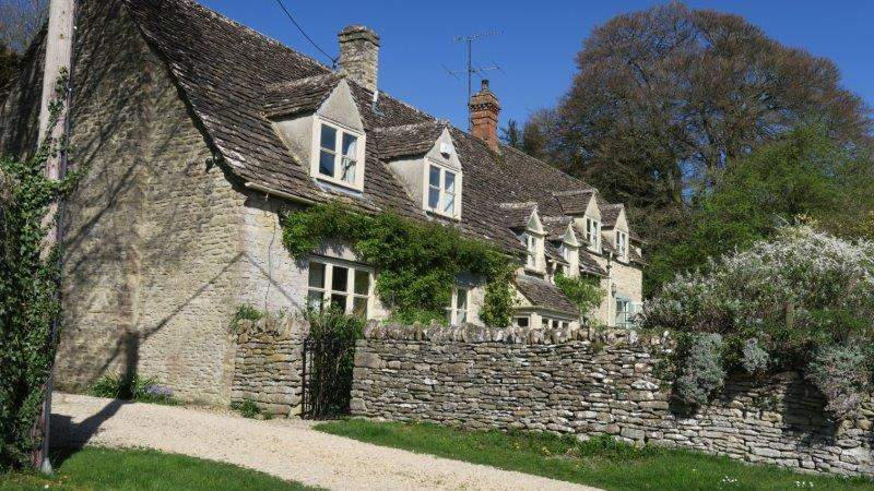 With the usual Cotswold stone cottages