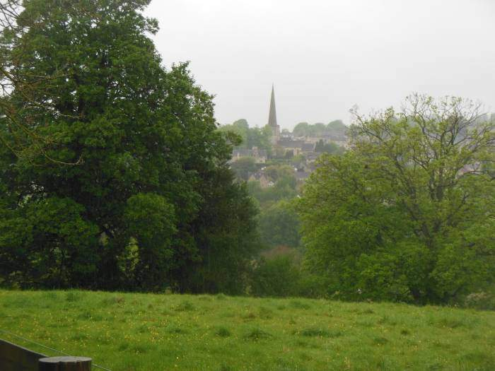 We look back at Painswick with the spire of St. Mary's church
