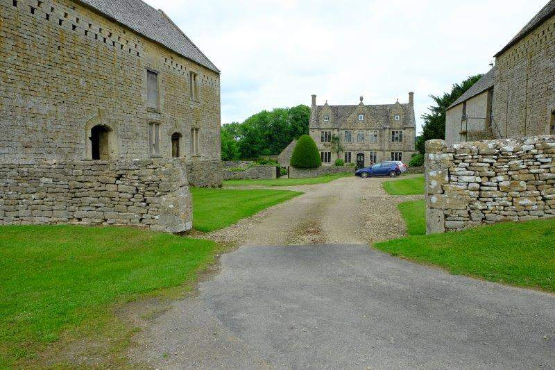 With a farmhouse and imposing outbuildings
