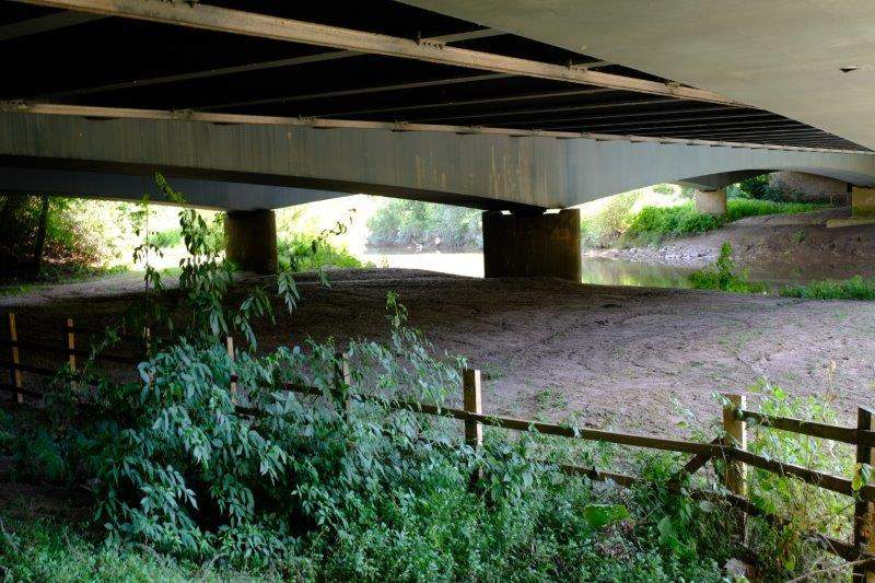 Before following the path under the road bridge