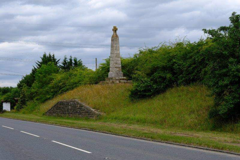 Crossing the Newent road by a familiar monument