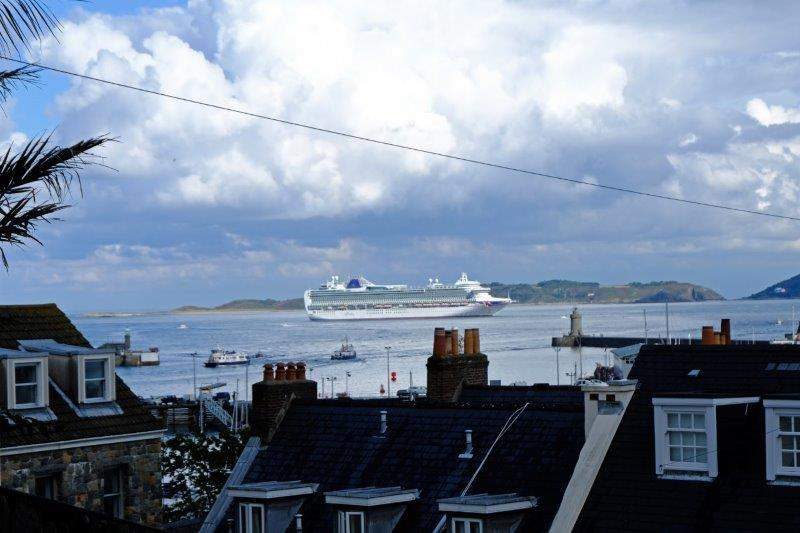 As we drop down into town we spot a cruise ship in the harbour