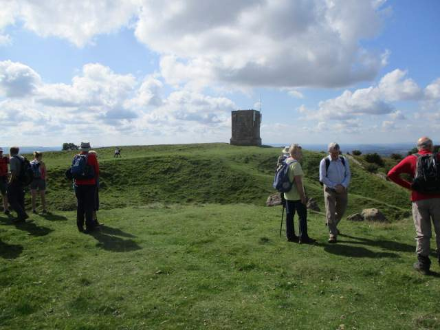 At the iron age hill fort, the stone tower now supporting telecommunications equipment